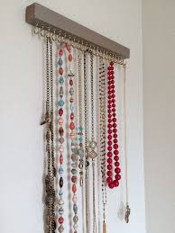 A necklace holder was needed to keep jewelry out of the hands of little  ones while