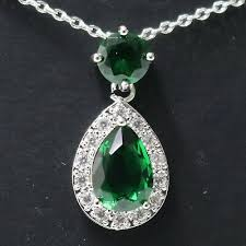 pear green emerald halo pendant