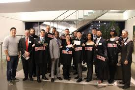 wesleyan welcomes second cohort of posse veteran scholars news the newly accepted class of posse veteran scholars holding wesleyan shirts together some