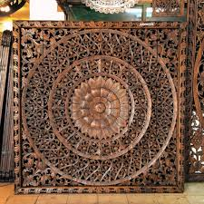 carved headboards and wooden wall art