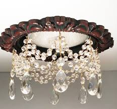 recessed light trim in antique cherry finish with 3 strands of faceted crystals and 1