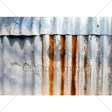 Rusted corrugated metal fence Ribbed Metal Rusty Corrugated Galvanized Sheet Iron Fence Gl Stock Images Rusty Corrugated Galvanized Sheet Iron Fence Gl Stock Images