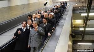 people on escalator. grigny station in paris people on escalator o