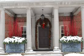 A This Is Very Big Porch That Features Pair Of Large Branch Boxes  Lacking Garland This Front Door Would Look Uninviting