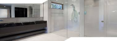wide shot showing clear shower glass screens and panels for a wall in shower