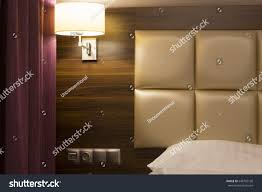 Headboard Light Switch Bedroom Fragment Featuring Curtain Wall Lamp Stock Image
