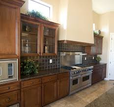 traditional kitchen design with glass kitchen cabinet doors dark black pearl granite countertops and