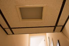 ugly light fixture in drop ceiling