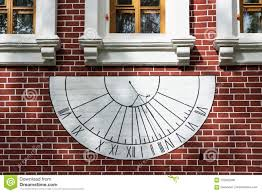 Wall Sundial Design Sundial On The Wall Of An Old Red Brick House Stock Photo