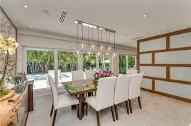 high ceiling lighting. contemporary dining room with pendant light limestone tile floors high ceiling oberon 5 lighting n