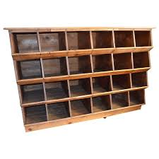 storage shelving unit of wood was once en nesting box for