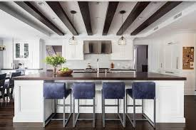 blue leather counter stools at wood top island