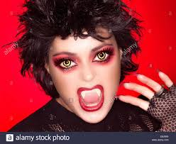 Nice Beautiful Caricature Of Gothic Girl Screaming With Fancy Makeup, Wolf  Lenses And Big Fangs