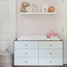 floating shelf over nursery dresser