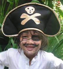 pirate hat and face paint on child
