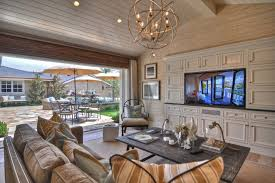 los angeles pottery barn edison chandelier living room beach style with wall art person outdoor dining tables sloped ceiling