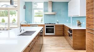 white cabinets white countertop kitchen medium brown wood cabinets blue tile white chrome faucet white kitchen white cabinets white countertop