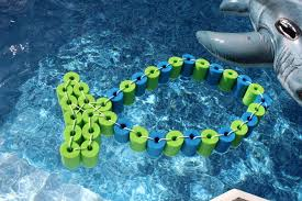 diy pool noodle fish float with headrest in the pool pool float diy