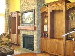 hanging a flat screen tv over a gas fireplace hanging a over a gas fireplace do we dare install a flat over the electronics hanging a over a gas fireplace