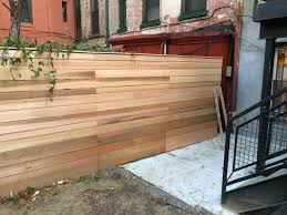 a reader constructed the fence above i built this out of cedar 4 6 8 and 12 widths with 4 4 pressure treated posts set in concrete wood was from