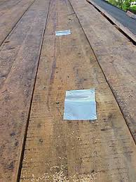 repair hole in roof plywood.  Hole Thin Flashing Metal Fastened Over Knot Holes In Roof Sheathing Boards Throughout Repair Hole In Roof Plywood