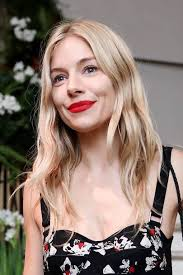 sienna miller loves a red pout and we love her for it this bright colour is the perfect y shade and looks gorgeous with barely there makeup