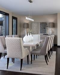 an angular modern dining table surrounded by traditional upholstered chairs is a typical exle of transitional design a rule of thumb you want the