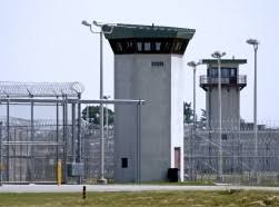 prison reform rand a prison fence and guard tower
