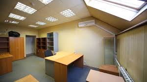 office work desks. Spacious Office Room With A Lot Of Empty Bookcases And Work Desks