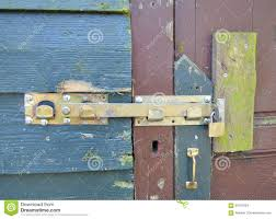 old locking system on an old wooden door