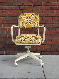 vintage office chair. fleur di lis vintage rolling office chair