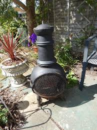 black metal chimnea 33 tall 15 wide 15 deep fire pit area 12 x12 used but not heavy located in coventry cv3 area thank you for looking one