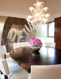 decorating adorable modern dining room with beautiful vase and flower as dining room centerpieces also brown gany round table and white