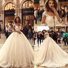 2018 Designer Gown 2018 Designer New 1 2 Long Sleeves Tulle Ball Gown Wedding Dresses Tulle Lace Applique Sweep Train Bridal Wedding Gowns Wedding Dresses Bridal Wedding