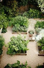 gridded raised beds and pea gravel courtyard garden at merci paris poer