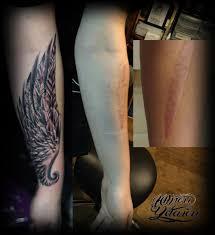 татуировка крыло перекрытие шрама тату салон юрец удалец