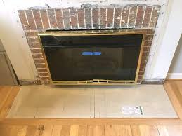 first layer of cement backer board in place in fireplace hearth