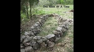 rock wall raised garden bed part 1