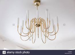 Modern Gold Chandelier On A Ceil In Living Room Interior