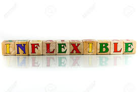 inflexible. inflexible colorful wooden word block on the white background stock photo - 42582289 y