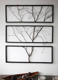 An actual tree branch in three separate frames. Use a thicker branch and  smaller frames for jewelry?