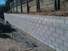 building a block retaining wall s cost to build besser how breeze uk cinder