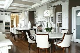 round white marble top dining table with ivory linen curved chairs melbourne