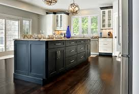open kitchen design in modern transitional style has large black island cabinets black crown molding