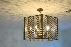personally i like the little flecks and appaly we have a thing for patterned light we have this chandelier in the master a chandelier with seeded