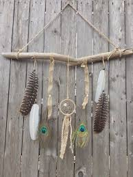 This combination of feathers, dreamcatchers, and a piece of driftwood are  gorgeous.