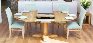 circa ii round oak dining table with extension open