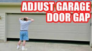 how to adjust garage door opener to fix gap at the bottom or top