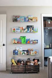 Toy Storage Furniture Living Room Organize The Piles Of Toys In This Toy Storage Console Three Open