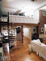 Spiral staircase leads to the bedroom at the mezzanine level.